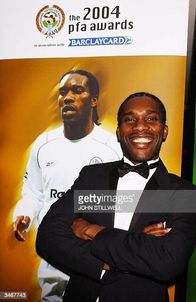 Bolton's Jay Jay Okocha arrives at the PFA Awards Dinner at the Grosvenor House Hotel in central London, on 25 April 2004. The Nigerian midfielder...