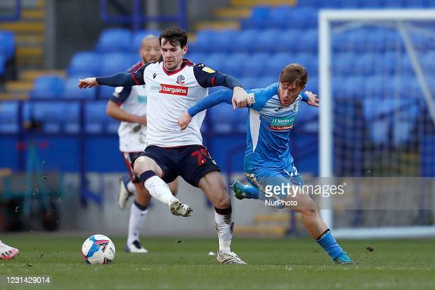 Boltons Kieren Lee battles with Barrows Luke James during the Sky Bet League 2 match between Bolton Wanderers and Barrow at the Reebok Stadium,...