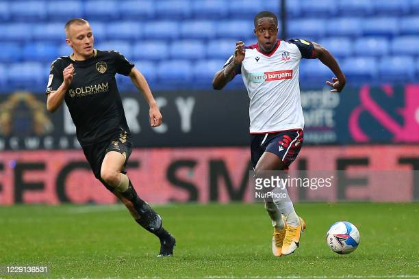 Boltons Liam Gordon gets passed Oldhams Jordan Barnett during the Sky Bet League 2 match between Bolton Wanderers and Oldham Athletic at the Reebok...