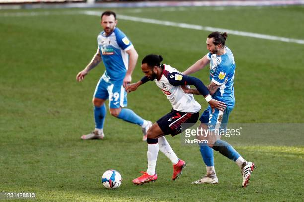 Boltons Nathan Defounesco battles with Barrows Ollie Banks during the Sky Bet League 2 match between Bolton Wanderers and Barrow at the Reebok...