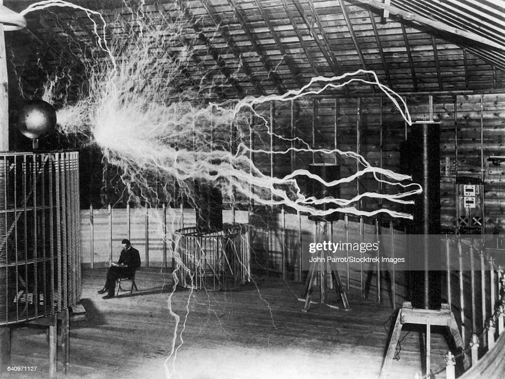 Bolts of electricity discharging in the lab of Nikola Tesla. : Stock Photo