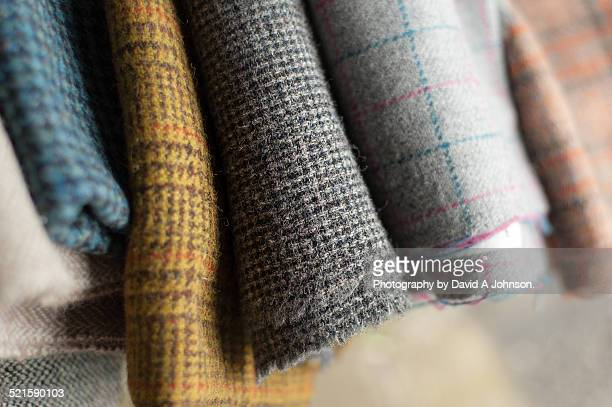 bolts of fabric-harris tweed. - tweed stock pictures, royalty-free photos & images