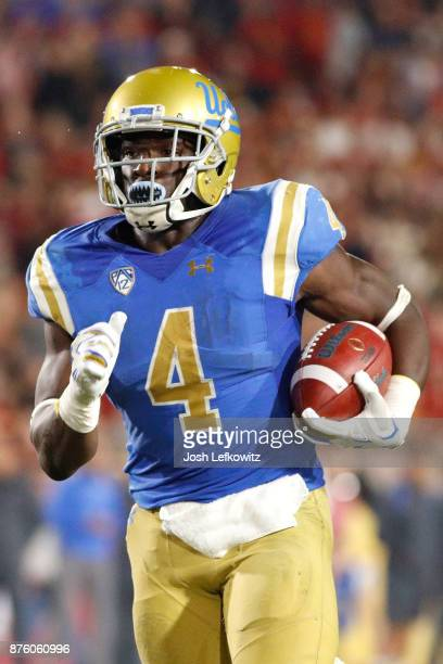 Bolu Olorunfunmi of the UCLA Bruins runs the ball down field during the NCAA college football game against the USC Trojans at the Los Angeles...