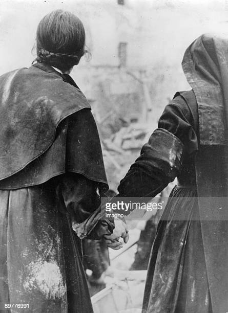 Bomb attempt on the Castello Gandolfo two nuns in front of the ruins Photograph Febraury 19th 1944