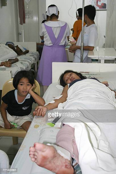 A bomb blast victim recovers in a hospital outside Makilala town 11 October 2006 following a bomb attack during a public celebration marking the...