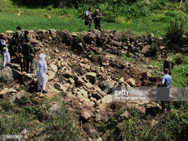 A bomb crater in a meadow in a remote area of Pakistan left behind after an Indian fighter jet attempted to strike a mountaintop building it said was...