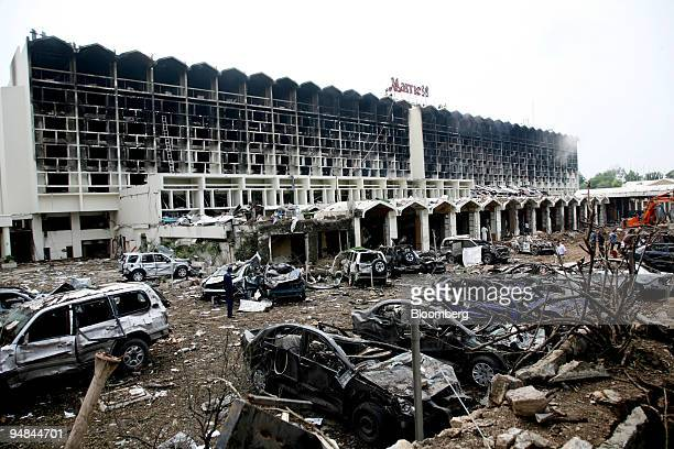 Bomb damaged cars litter the forecourt of the Marriott hotel in Islamabad Pakistan on Sunday Sept 21 2008 The suicide bombing yesterday of the...