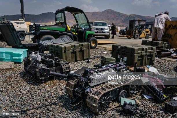 Bomb defuser robots could be seen dismantled after Taliban fighters take control and secure the Hamid Karzai International Airport, along with all...
