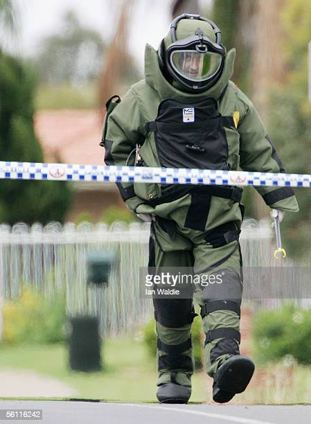 A bomb disposal officer walks down Wilson Street in Green Valley November 8 2005 in Sydney Australia Sixteen people have been arrested in Sydney and...