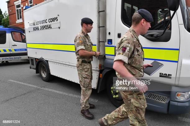 A bomb disposal team attends the scene of a raid in the Moss Side area as part of the ongoing police investigation following the terror attack...