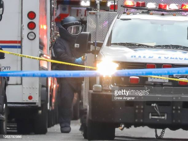 A bomb disposal technician carries a package out of a US Post Office facility at 52nd Street and 8th Avenue in Manhattan October 26 2018 in New York...