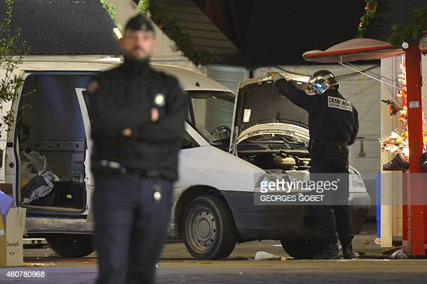 Bomb disposal unit inpect the van a driver used to plough into a Christmas market injuring at least ten people before stabbing himself in the western...