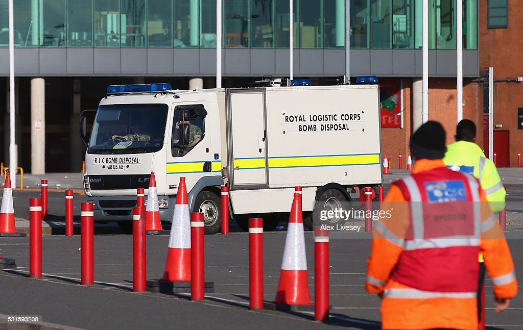 A bomb disposal unit is seen outside Old Trafford after the