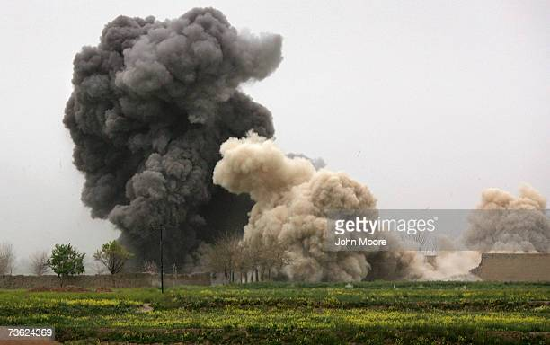Bomb dropped by a B-1 Bomber explodes on a Taliban position after an air strike was called in during a British commando offensive on March 18, 2007...