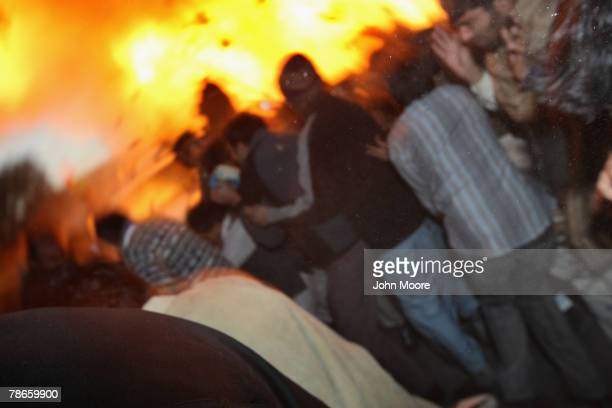 Bomb explodes next to the vehicle of former Prime Minister Benazir Bhutto on December 27, 2007 following a political rally in Rawalpindi, Pakistan....