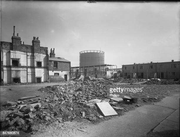A bomb site in Poplar east London 2nd January 1947 On the right are recentlybuilt temporary homes with more under construction at centre