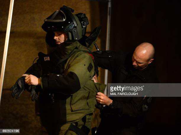 A bomb squad member suits up ahead of entering a residential building in the Melbourne bayside suburb of Brighton on June 5 after a woman was held...
