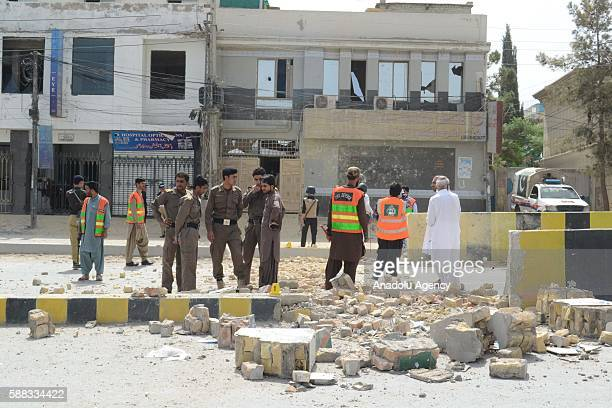 Bomb squad members inspect the area after a blast near AlKhair Hospital on Zarghoon Road in Quetta Pakistan on August 11 2016 At least 12 people were...