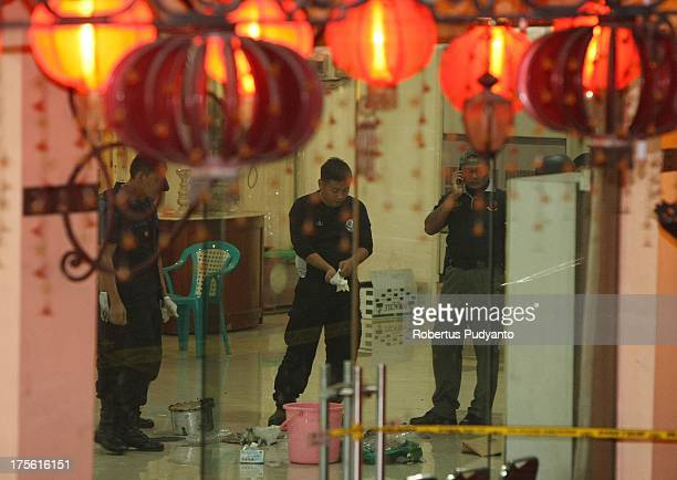 Bomb Squad Police officers investigate the crime scenes at Ekayana Buddhist Temple District Duri Kepa Tanjung Duren on August 4 2013 in Jakarta...