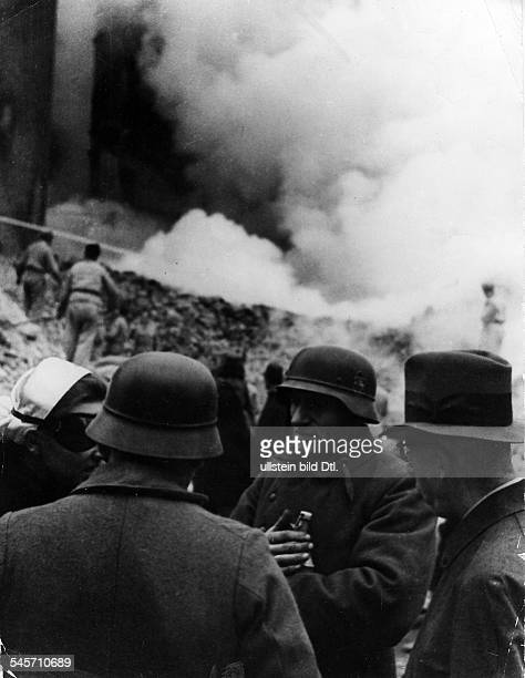 2 WORLD WAR BERLIN Bomb War A Red Cross nurse and members of a German air raid rescue team on the Leipziger Strasse in Berlin Germany following an...