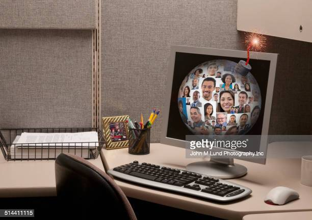 Bomb with business people on computer screen in cubicle