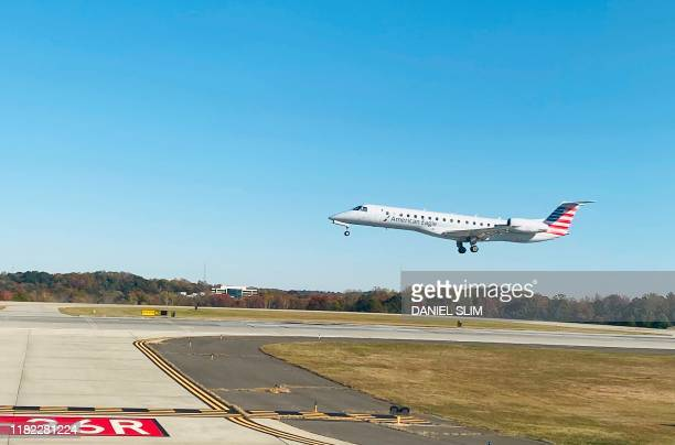 Bombardier CRJ-700 of American Airlines approaches the runway to land at Charlotte Douglas International Airport on November 13, 2019 in Charlotte,...