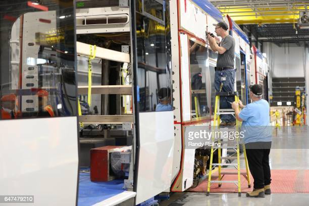 Bombardier employees assembling the Region of Waterloo's new ION light rail vehicle at Bombardier's Millhaven plant This facility also makes vehicles...