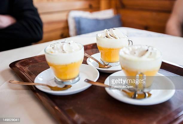 Bombardino a hot egg liqueur advocaat with whipped cream a typical aprÃsski hard liquor booze drink at the bar of the alpine mountain hut Rifugio...