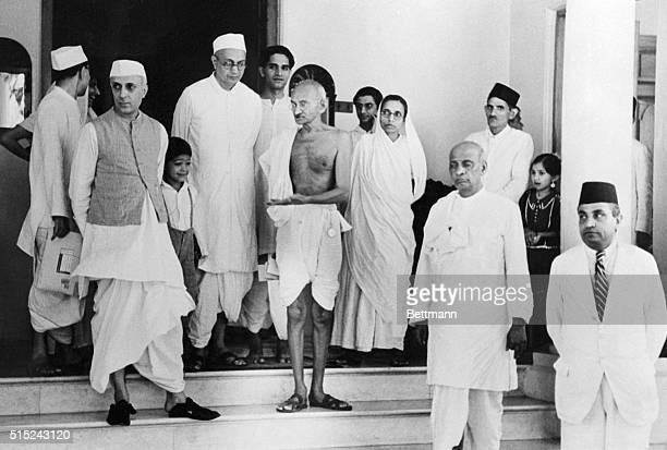 Mahatma Mohandas K Gandhi Indian political and spiritual leader outside of his new residence 'Birla House' in Bombay Accompanying Mahatma is Pandit...