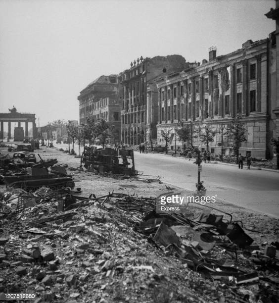 Bomb-damaged buildings and military vehicles show the destruction along the Unter Den Linden leading to the Brandenburg Gate in July 1945 following...