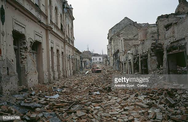 Bombed buildings are riddled with bullet holes and streets are filled with rubble after a threemonth battle between the Croatian armed forces and the...