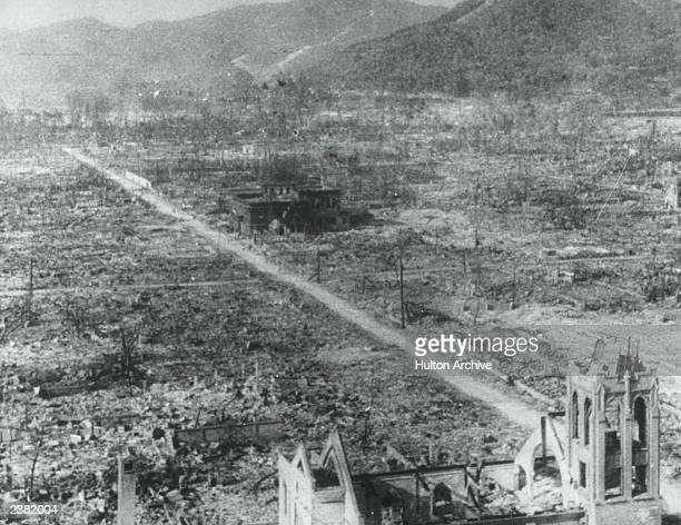 Bombed out landscape in Hiroshima, Japan, following the explosion of the first atomic bomb. A few remaining buildings stand guard in a completely...