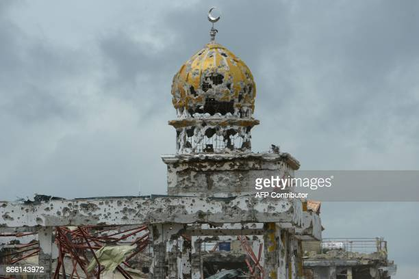 A bombedout mosque stands in what was the main battle area in Marawi on the southern island of Mindanao on October 25 days after the military...