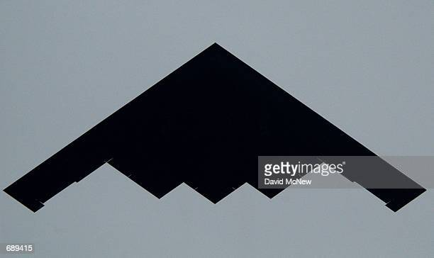 B2 bomber creates a menacing black shape in the sky during a flyover of the 113th Annual Rose Parade January 1 2002 in Pasadena CA The bomber was...