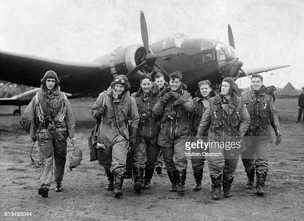 Bomber crews of No 83 Squadron in front of a Handley Page Hampden bomber at RAF Scampton, Lincolnshire, October 1940.