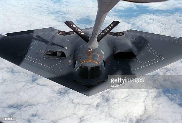 A B2 bomber from Whiteman Air Force Base MO approaches a KC135R Stratotanker for refueling for the flight back home in an undated photo The USled...