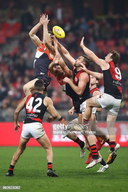 Bombers and Giants players contest the ball during the round 10 AFL match between the Greater Western Sydney Giants and the Essendon Bombers at...