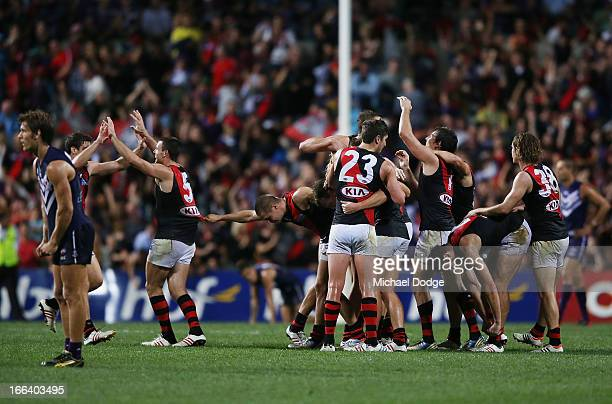 Bombers celebrate their win after the final siren during the round three AFL match between the Fremantle Dockers and the Essendon Bombers at...