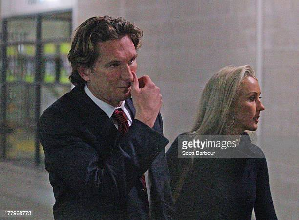 Bombers coach James Hird and his wife Tania Poynton leave after attending the Essendon Bombers AFL Commission Hearing at AFL House on August 26 2013...