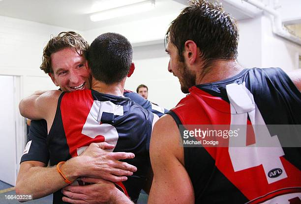 Bombers coach James Hird celebrates the win with Jobe Watson and Brent Stanton during the round three AFL match between the Fremantle Dockers and the...