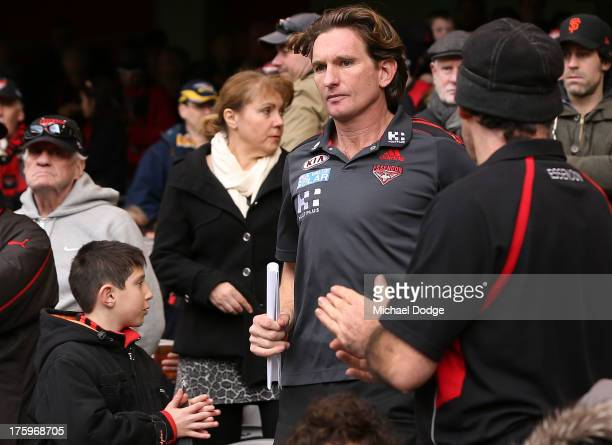 Bombers coach James Hird is clapped by fans at three quarter time during the round 20 AFL match between the Essendon Bombers and the West Coast...