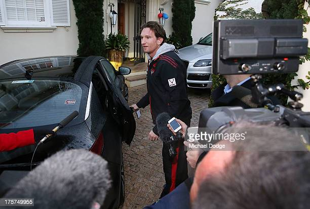 Bombers coach James Hird is questioned by media as as he leaves his house to travel to training at Windy Hill on August 8 2013 in Melbourne Australia
