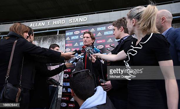 Bombers coach James Hird speaks at his press conference in front of his grandfather's stand during an Essendon Bombers AFL training session at Windy...