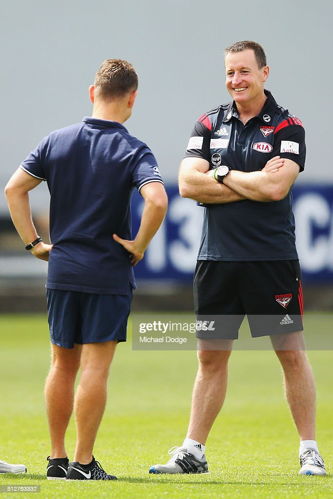 Bombers coach John Worsfold (R) talks to Blues coach Brendon Bolton during the 2016 AFL NAB Challenge match between Carlton and Essendon at Ikon Park on February 28, 2016 in Melbourne, Australia.