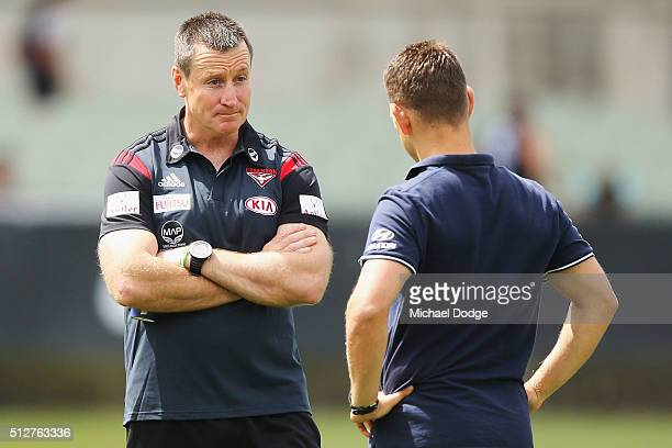 Bombers coach John Worsfold talks to Blues coach Brendon Bolton during the 2016 AFL NAB Challenge match between Carlton and Essendon at Ikon Park on...