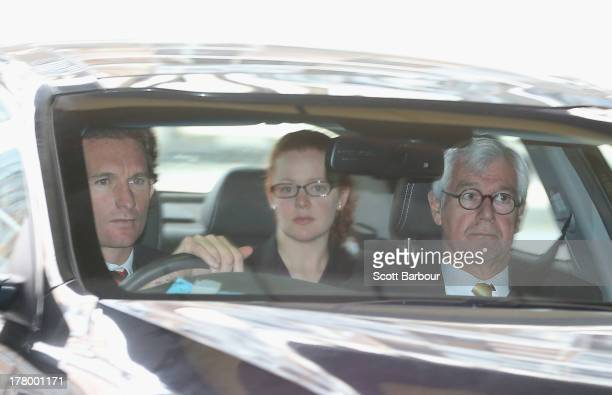 Bombers coah James Hird and lawyer Julian Burnside QC arrive at the Essendon Bombers AFL Commission Hearing at AFL House on August 27 2013 in...