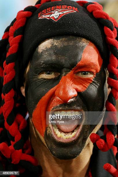 Bombers fan cheers during the round eight AFL match between the Brisbane Lions and the Essendon Bombers at The Gabba on May 10 2014 in Brisbane...