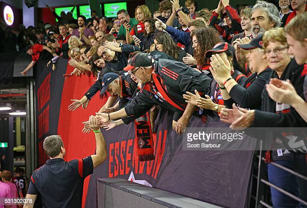 Bombers fans in the crow show their support as John Worsfold coach of the Bombers leaves the field after losing the round eight AFL match between the...