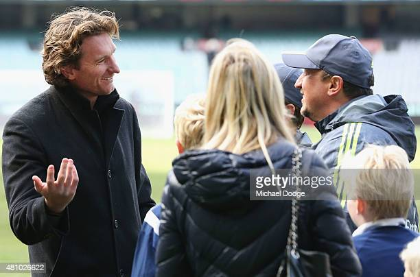 Bombers head coach James Hird talks with Real Mardid Head Manager Rafa Benitez after a Real Madrid training session at Melbourne Cricket Ground on...