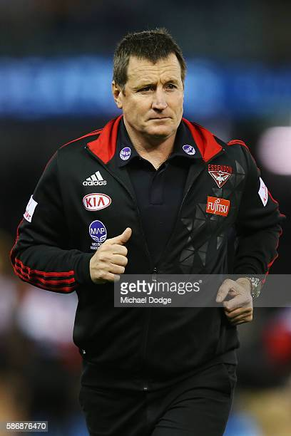 Bombers head coach John Worsfold runs off during the round 20 AFL match between the Geelong Cats and the Essendon Bombers at Etihad Stadium on August...